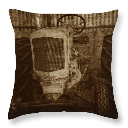 Crank Tractors Throw Pillow featuring the photograph Ol Yeller In Sepia by Ernie Echols