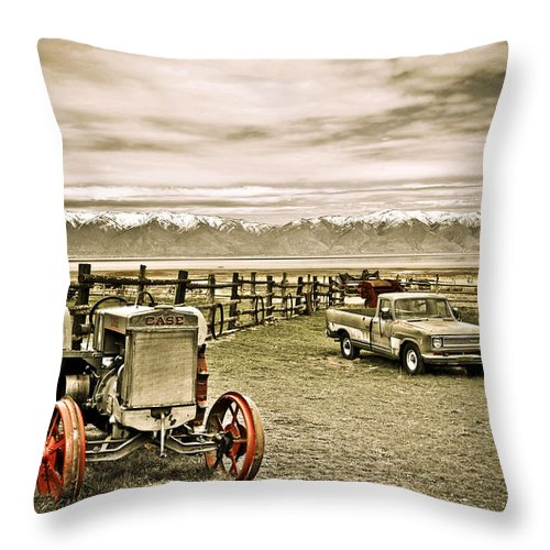 Utah Throw Pillow featuring the photograph Old Case Tractor by Marilyn Hunt