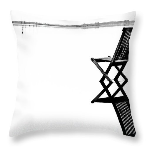 Landscape Throw Pillow featuring the photograph Old Chair In Calm Water by Gert Lavsen