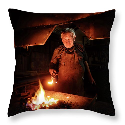 Blacksmith Throw Pillow featuring the photograph Old-fashioned Blacksmith Heating Iron by Johan Swanepoel