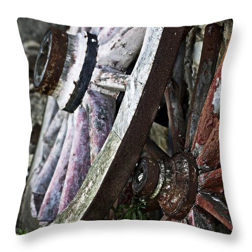 Old Throw Pillow featuring the photograph Old Wagon Wheels by Marilyn Hunt
