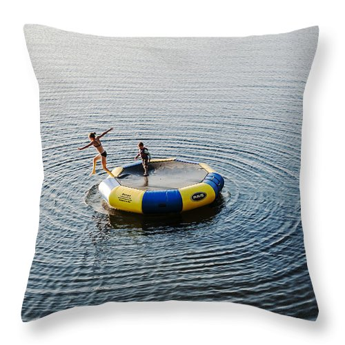 Lake Throw Pillow featuring the photograph On The Lake by Enrico Della Pietra
