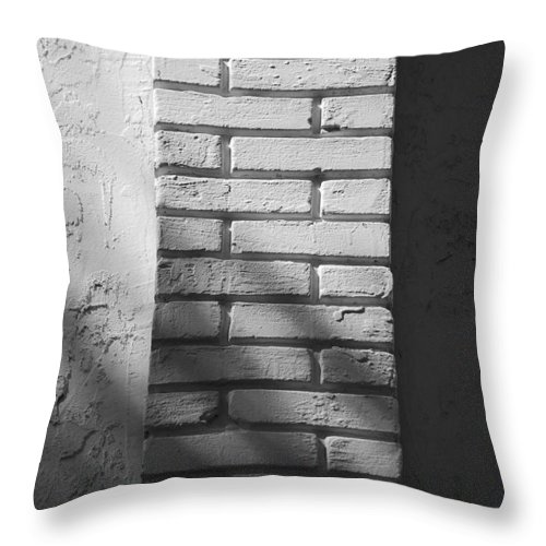 Black And White Throw Pillow featuring the photograph Outside The Wall by Rob Hans