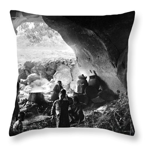 1910s Throw Pillow featuring the photograph Palestine: Cave Dwelling by Granger