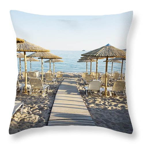 Beach Throw Pillow featuring the photograph Parasol And Sunbeds At Sunset by Newnow Photography By Vera Cepic