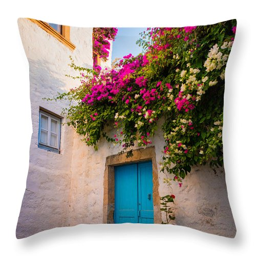 Aegean Sea Throw Pillow featuring the photograph Patmos Bougainvillea by Inge Johnsson