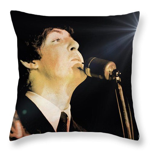 Beatles Throw Pillow featuring the photograph Paul McCartney by Larry Mulvehill
