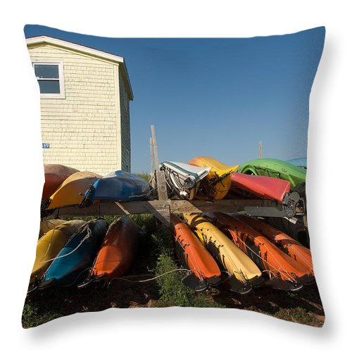 Scenic Throw Pillow featuring the photograph Pei Kayaks Building And Sky by Steve Somerville