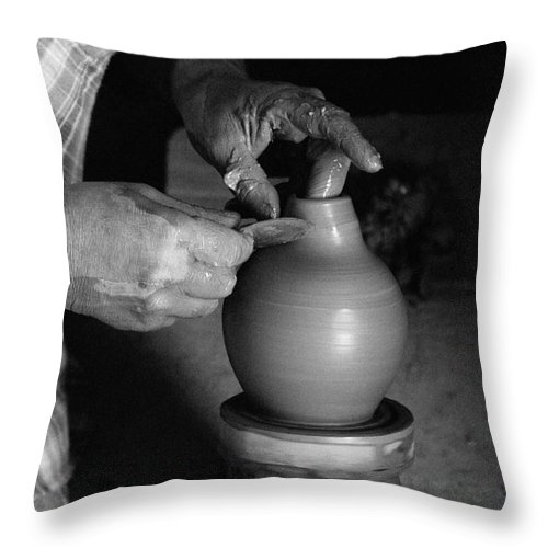 Azores Throw Pillow featuring the photograph Potter At Work by Gaspar Avila