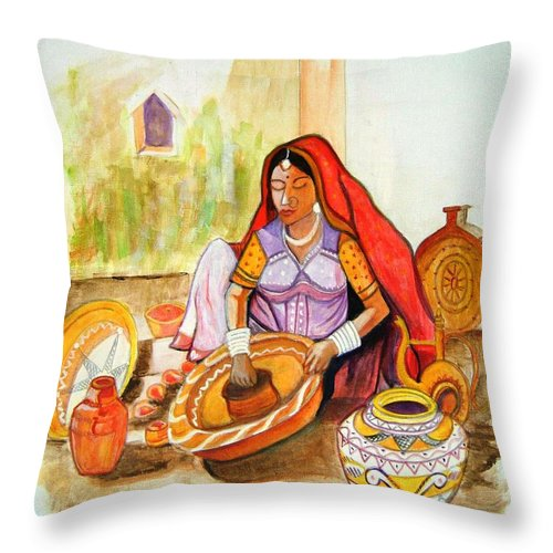 Rajasthan Throw Pillow featuring the photograph Potters Wife-Rajasthani by Manjiri Kanvinde