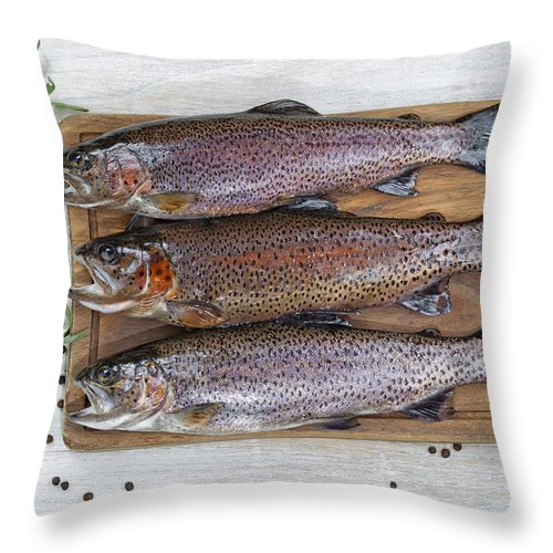 Fish Throw Pillow featuring the photograph Preparing Trout For Dinner by Thomas Baker