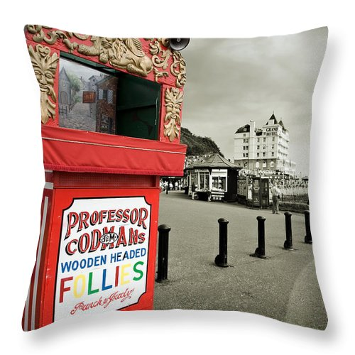 Punch And Judy Throw Pillow featuring the photograph Punch And Judy Theatre On Llandudno Promenade by Mal Bray