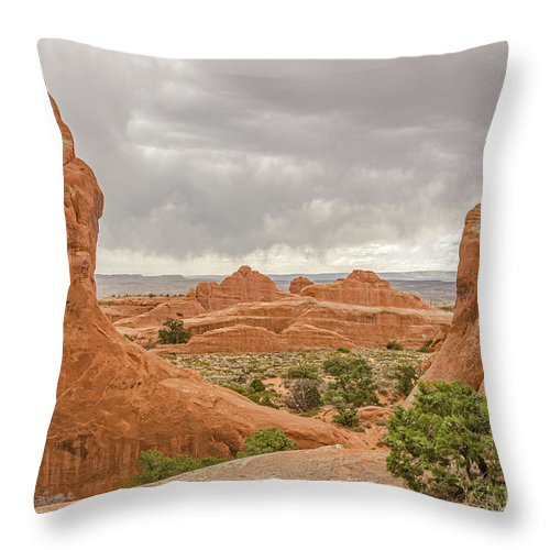 Arches National Park Throw Pillow featuring the photograph Rain In The Distance At Arches by Sue Smith