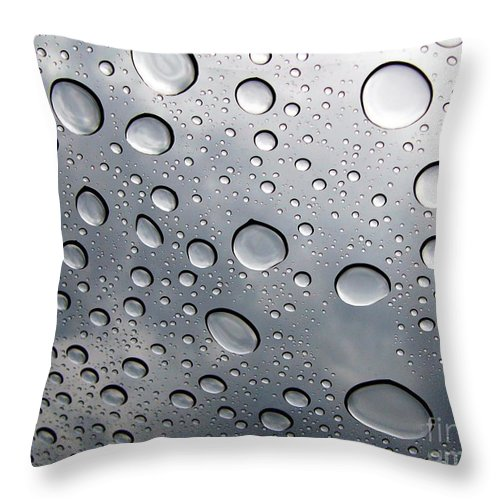 Rain Throw Pillow featuring the photograph Raindrops by Kenna Westerman