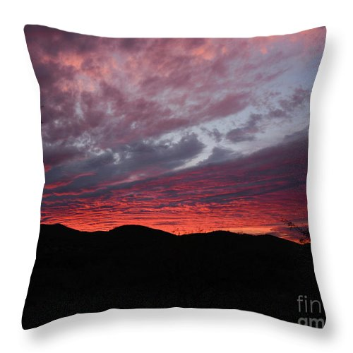 Red Throw Pillow featuring the photograph Red Cloud Sunset by Katie Brown