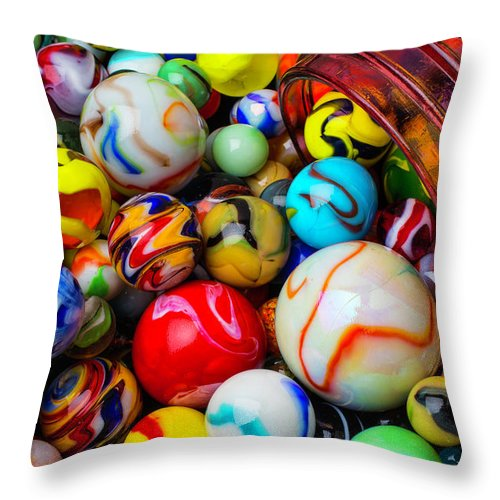 Glass Throw Pillow featuring the photograph Red Jar Spilling Marbles by Garry Gay
