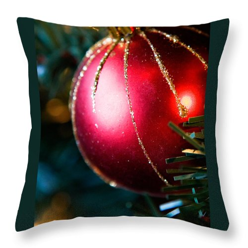 Red Throw Pillow featuring the photograph Red Shiny Ornament by Marilyn Hunt