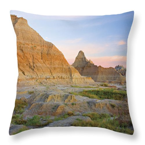 Badlands Throw Pillow featuring the photograph Red Sunrise On The Hills Of Badlands by Philippe Widling