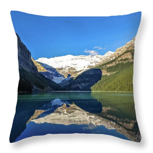 Alberta Throw Pillow featuring the photograph Reflections In The Water At Lake Louise, Canada by Daniela Constantinescu