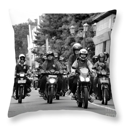 Riders Throw Pillow featuring the photograph Riders by Charuhas Images