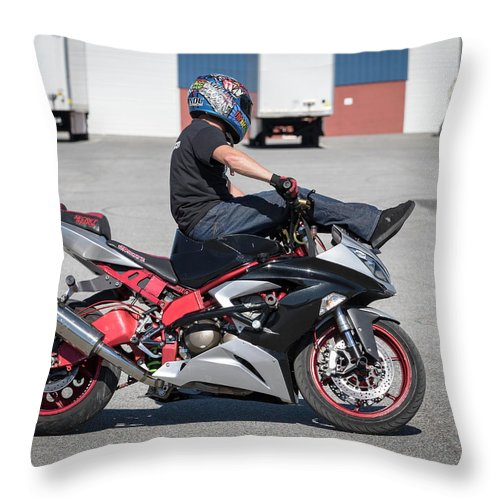 Stunts Throw Pillow featuring the photograph Riding On Handle Bars by Tony Fruciano