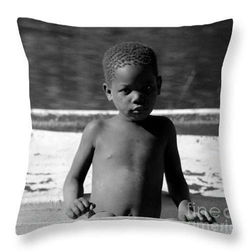 Boy Throw Pillow featuring the photograph River Boy by Roger Brown