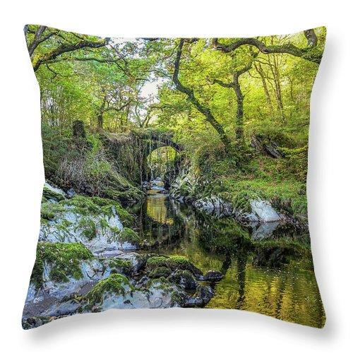 Roman Throw Pillow featuring the digital art Roman Bridge In Penmachno by Chris Evans