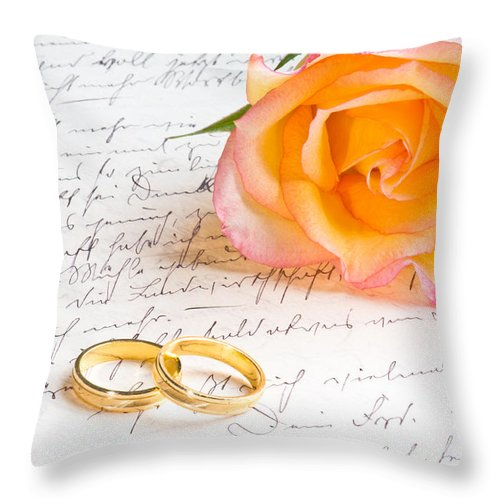 Alliance Throw Pillow featuring the photograph Rose And Two Rings Over Handwritten Letter by U Schade
