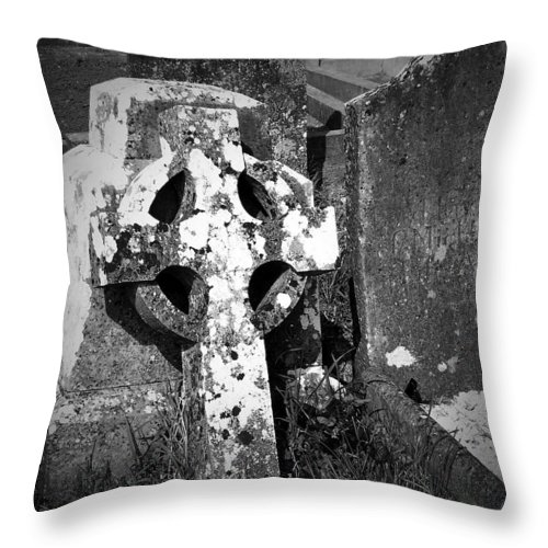 Celtic Throw Pillow featuring the photograph Rugged Cross At Fuerty Cemetery Roscommon Ireland by Teresa Mucha
