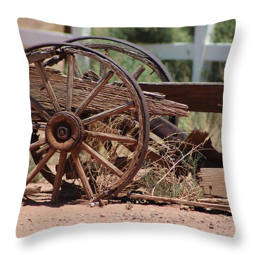 Wooden Throw Pillow featuring the photograph Rustic Wooden Wagon Wheel in Alamogordo New Mexico by Colleen Cornelius