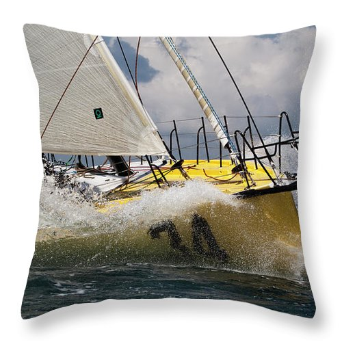 Sailboat Throw Pillow featuring the photograph Sailboat Le Pingouin Open 60 Charging by Dustin K Ryan