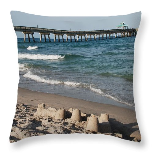 Sea Scape Throw Pillow featuring the photograph Sand Castles And Piers by Rob Hans