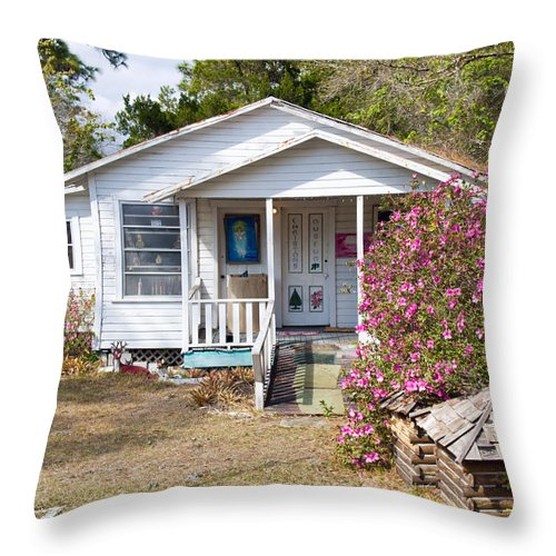Cabin Throw Pillow featuring the photograph Santa And Mrs Claus Spend The Spring Months Relaxing by Allan Hughes