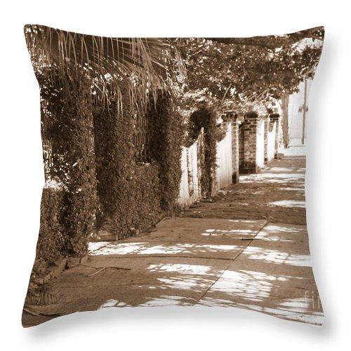 Savannah Throw Pillow featuring the photograph Savannah Sepia - Sunny Sidewalk by Carol Groenen