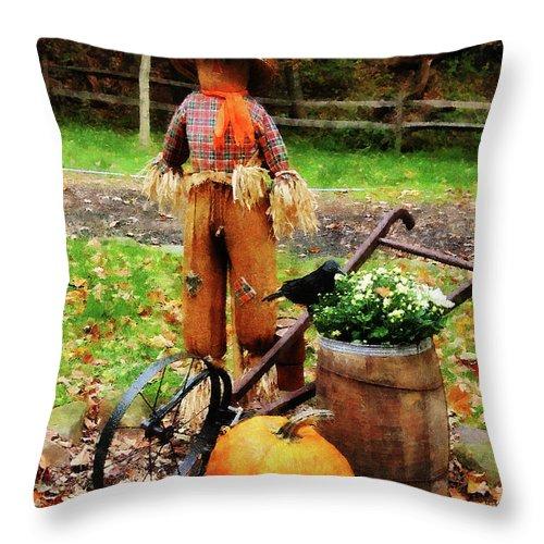 Autumn Throw Pillow featuring the photograph Scarecrow And Pumpkin by Susan Savad