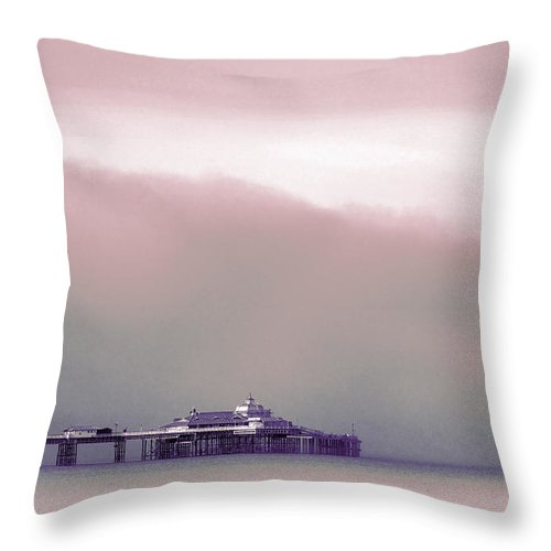 Pier Throw Pillow featuring the photograph Sea Mist Replaces The Great Orme As The Backdrop To Llandudno Pier by Mal Bray