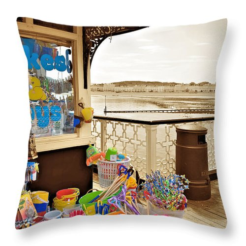 Seaside Throw Pillow featuring the photograph Seaside Buckets And Spades For Sale On Llandudno Pier by Mal Bray
