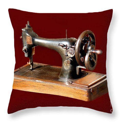 Sewing Machine Throw Pillow featuring the photograph Sewing Machine by Charuhas Images