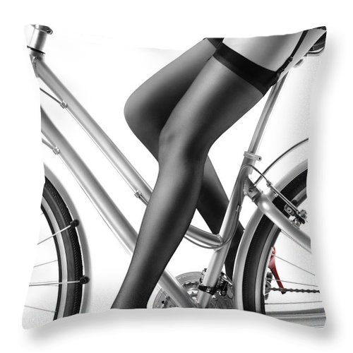 13669ae593a Bicycle Throw Pillow featuring the photograph Sexy Woman In Red High Heels  And Stockings Riding Bike
