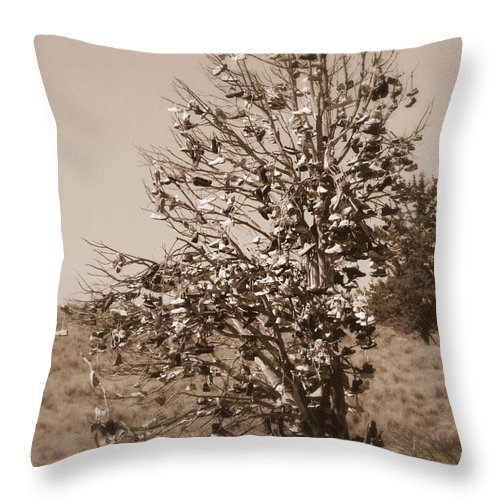 Sepia Throw Pillow featuring the photograph Shoe Tree In Sepia by Carol Groenen