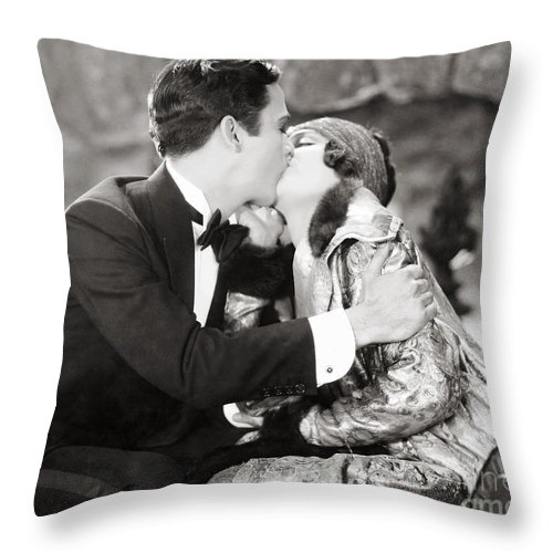 -kissing- Throw Pillow featuring the photograph Silent Film Still: Kissing by Granger
