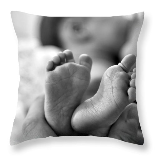 Babies Feet Throw Pillow featuring the photograph Small And Cute by Jeramey Lende
