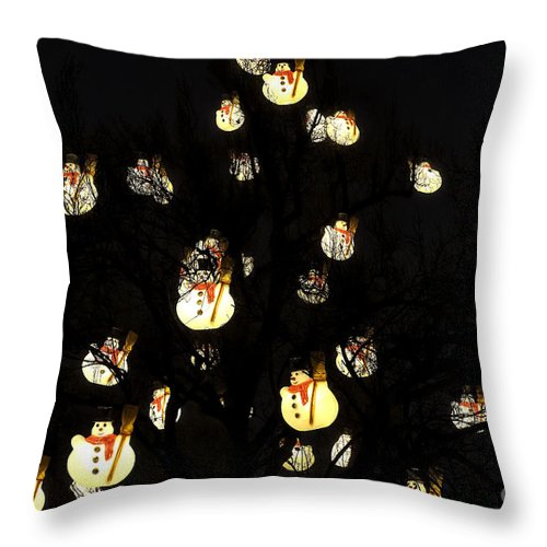 Snowmen In The Tree Throw Pillow featuring the photograph Snowmen In The Tree by John Rizzuto