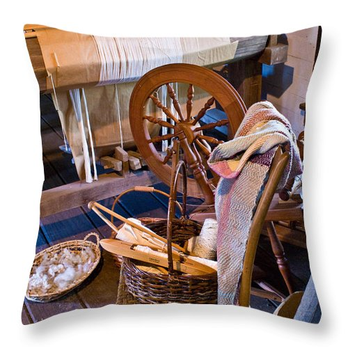 Spinning Throw Pillow featuring the photograph Spinning And Weaving by Douglas Barnett
