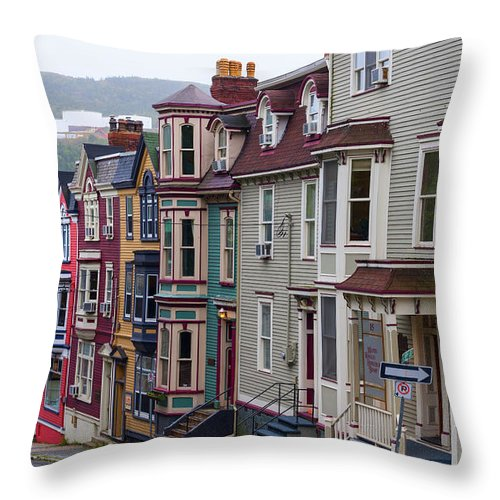 Colors Throw Pillow featuring the photograph St Johns In Newfoundland by Les Palenik