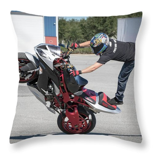 Stunts Throw Pillow featuring the photograph Standing On One Leg Riding Wheelie by Tony Fruciano