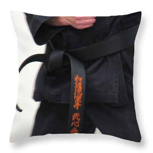 Karate Throw Pillow featuring the photograph Stands With Fist by Kelly Mezzapelle