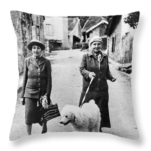 1944 Throw Pillow featuring the photograph Stein And Toklas, 1944 by Granger