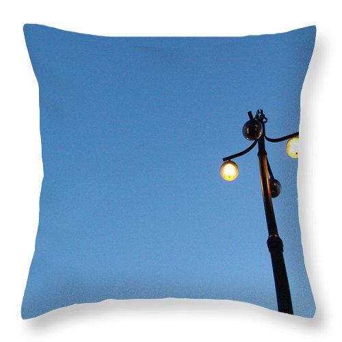 Sky Throw Pillow featuring the photograph Stockholm Street Lamp by Linda Woods