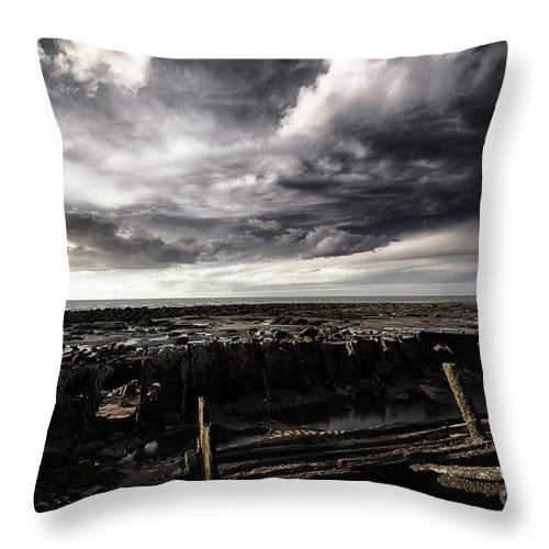 Storm Throw Pillow featuring the photograph Storm Clouds Over Beached Shipwreck by Simon Bratt Photography LRPS